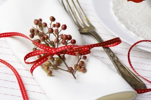 White napkin decorated with red ribbon Christmas plant, table se